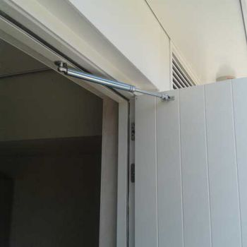 RVS deuropeningsbegrenzer  100kg met mechanische vaststelling